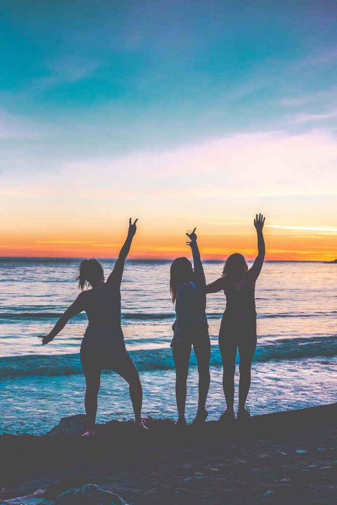 girl friends at the beach for sunset