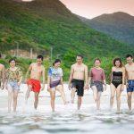 hawaii kids playing in ocean