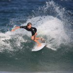 young kid surfing doing reverse cutback