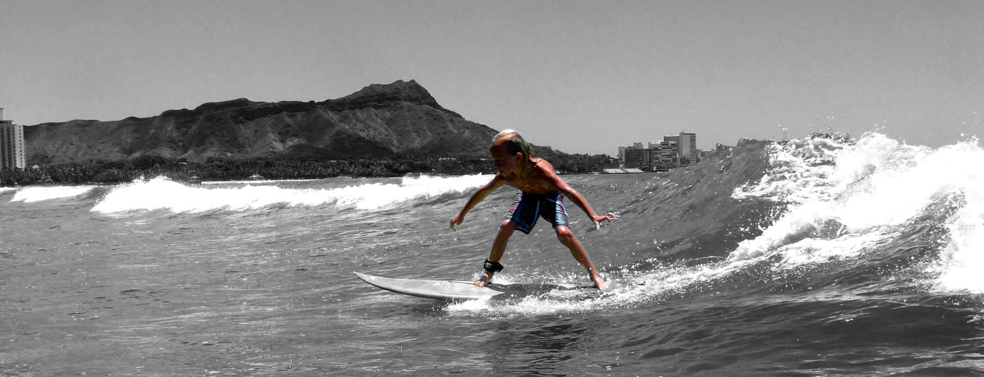 5 year old surfing waikiki shortboard