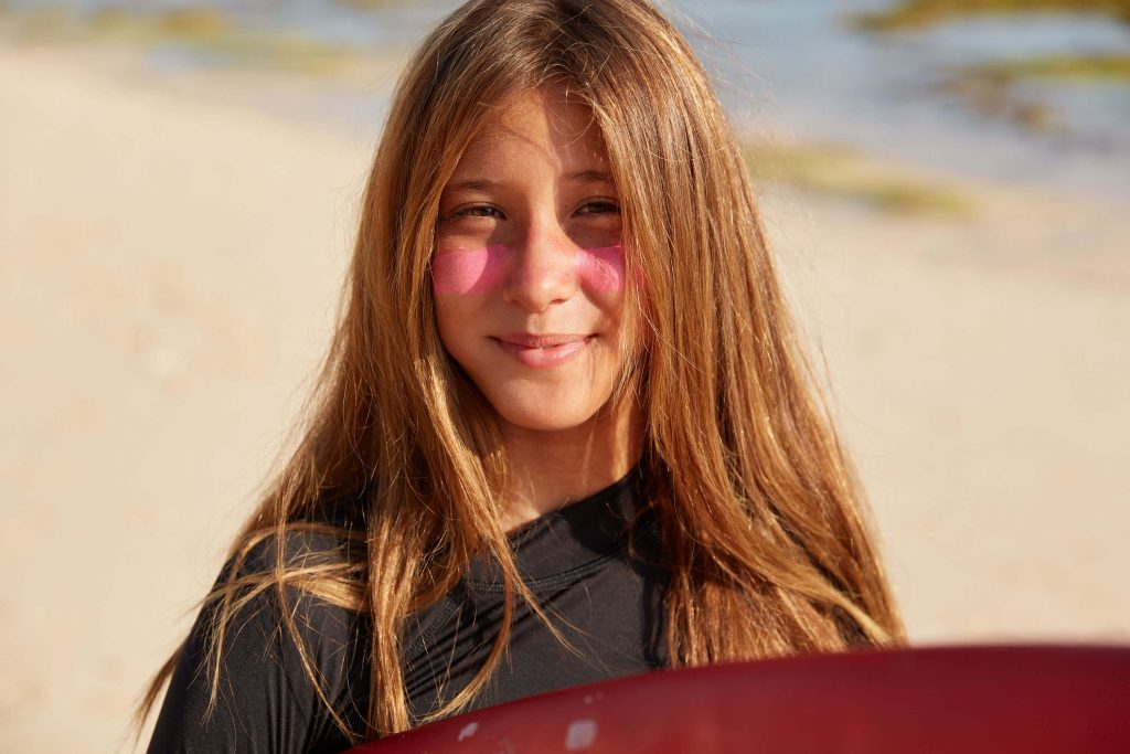 young surfer kid with zinc sunscreen