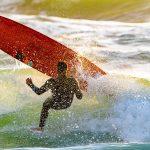 longboard surfer falling