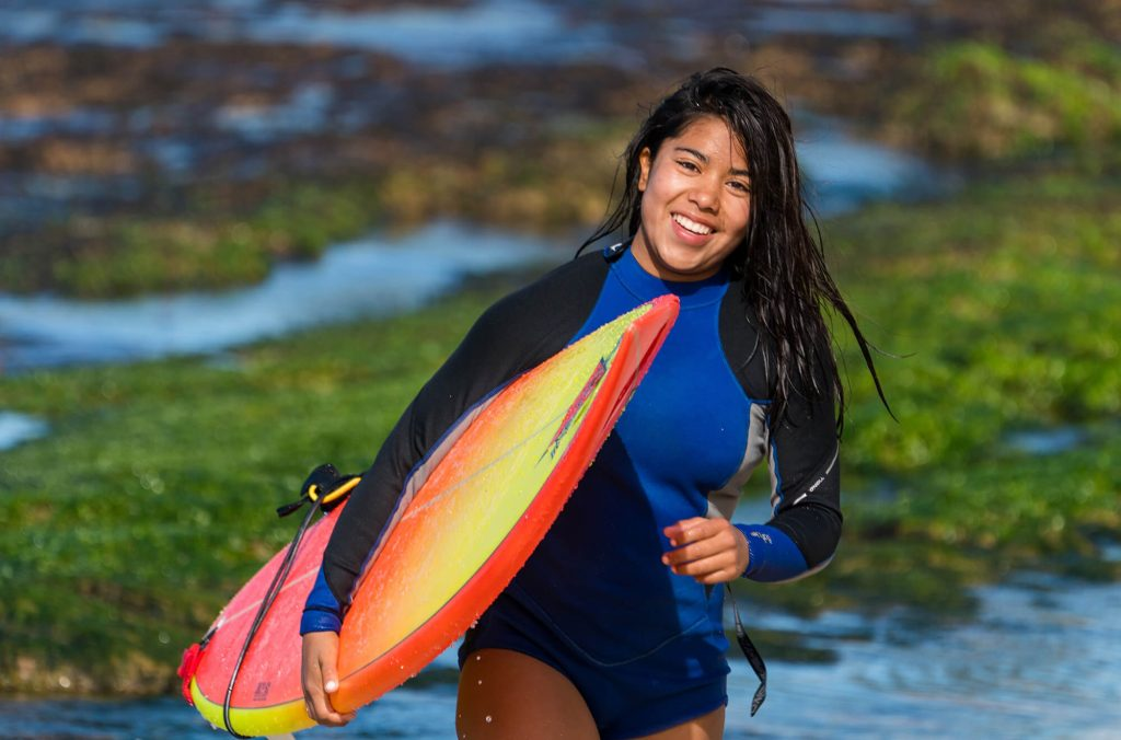 hawaii female surfer coming in