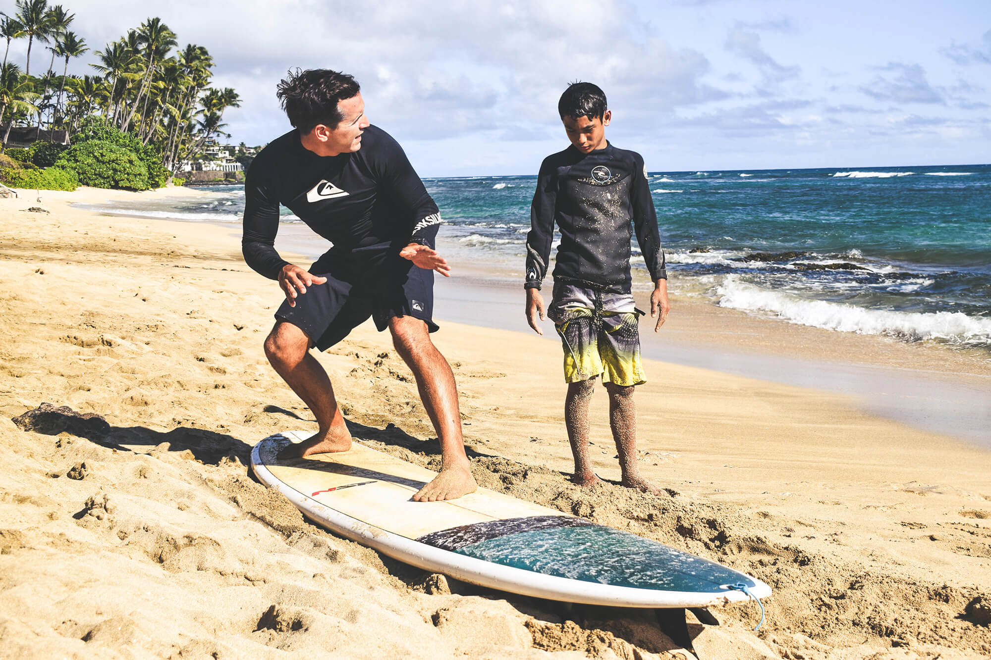 kid learning to surf on land